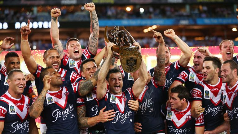 Roosters captain Anthony Minichiello hoists the NRL trophy aloft