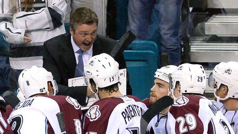 New Colorado Avalanche head coach Patrick Roy talks to his players