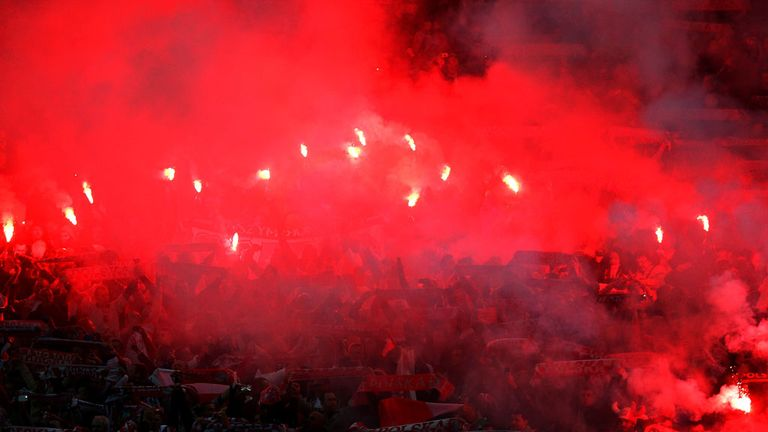 Poland fans set off flares during the game at Wembley