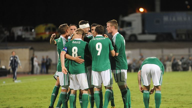 The Northern Ireland players celebrate Steven Davis' goal against Israel