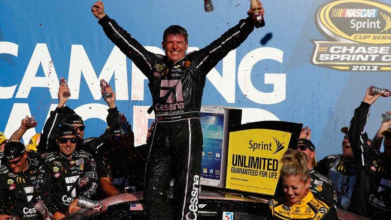 Jamie McMurray celebrates with his team after Talladega win