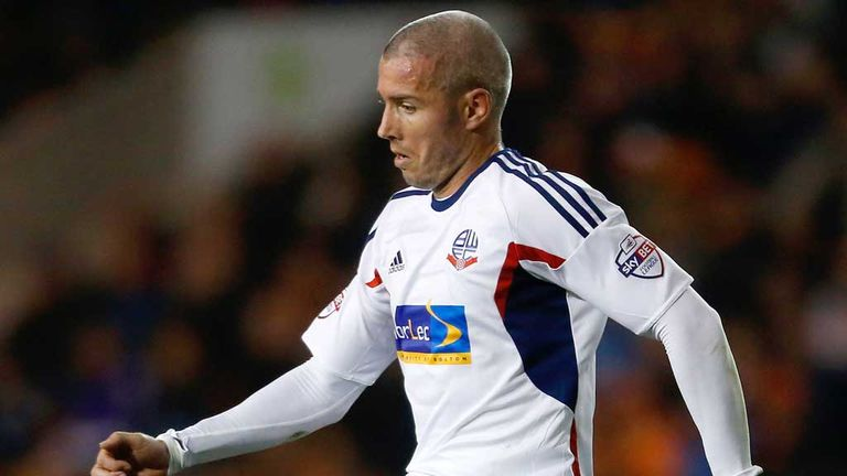 Kevin McNaughton: Scottish defender to remain with Bolton for a further two months