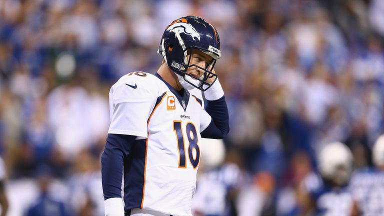 Peyton Manning walks off of the field after losing at the Indianapolis Colts