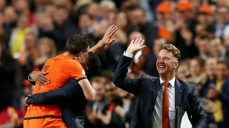 Robin van Persie: Manchester United striker celebrates with Patrick Kluivert and Louis van Gaal