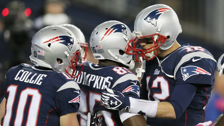 Tom Brady celebrates with Kenbrell Thompkins after they connected for the  winning touchdown