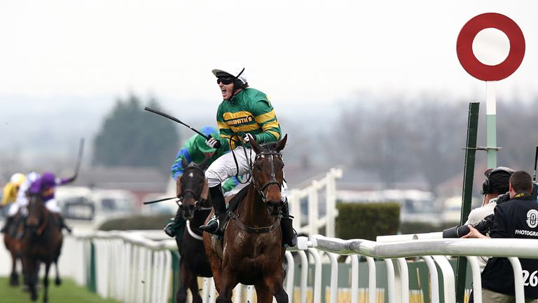 Tony McCoy salutes the crowd after winning the Grand National