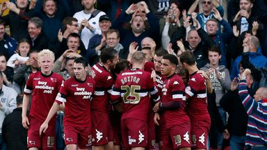 Jamie Ward: The striker is surrounded by his Derby team-mates after scoring