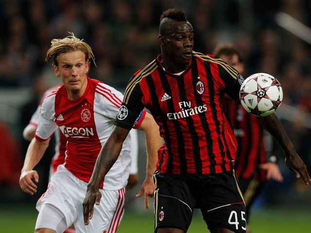 Mario Balotelli holds off Christian Poulsen