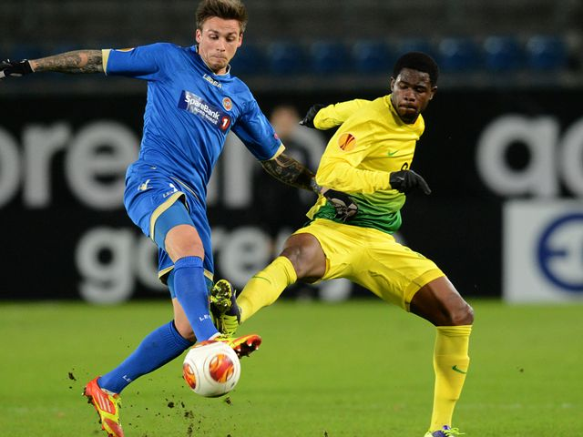 Steffen Nystrom vies with Ayodele Adeleye