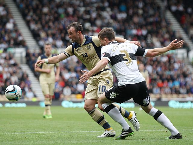Noel Hunt and Craig Forsyth battle for the ball
