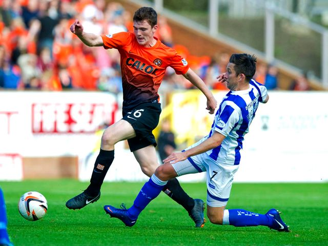 Andrew Robertson receives a challenge from Barry Nicholson