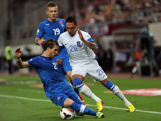Jose Holebas in action for Greece.
