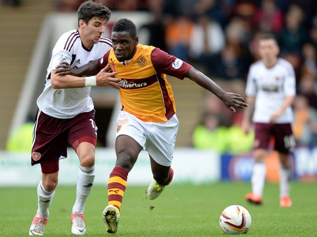 Callum Paterson competes for the ball with Zaine Francis Angol