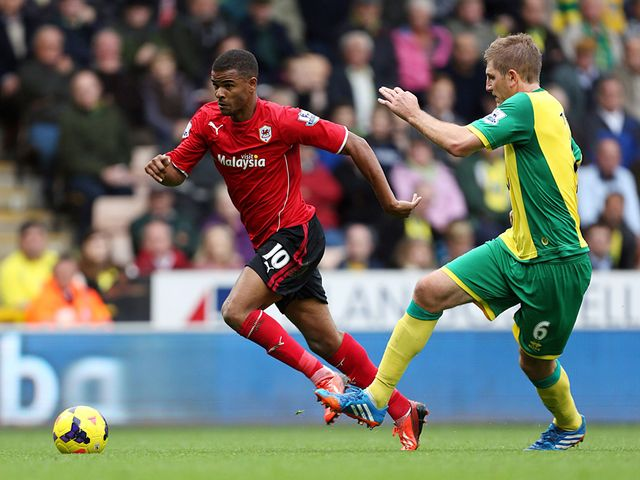 Fraizer Campbell tries to evade Michael Turner.