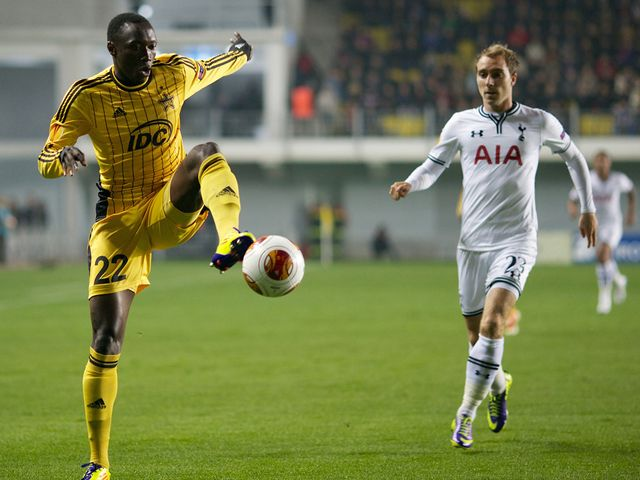 Djibril Paye brings the ball under control as Christian Eriksen closes him down
