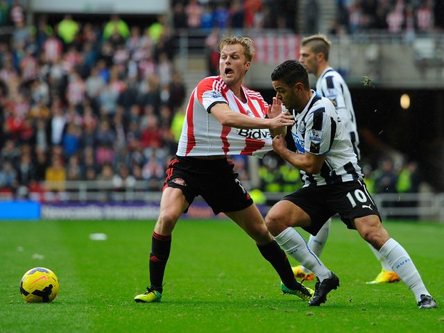 Hatem Ben Arfa tries to hold Sebastian Larsson