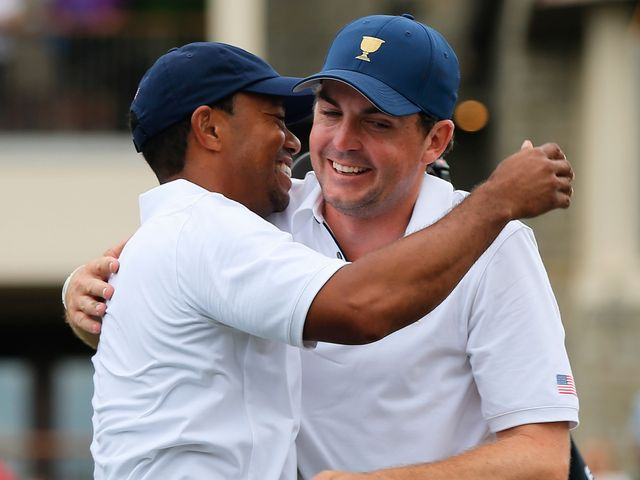 Tiger Woods celebrates wtih Keegan Bradley