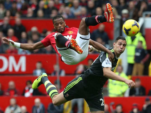 Patrice Evra and Geoff Cameron clash.