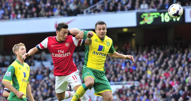 Mesut Ozil: Heads home Arsenal's second goal