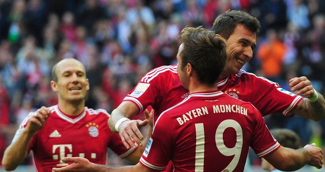 Mario Mandzukic celebrates with Mario Goetze