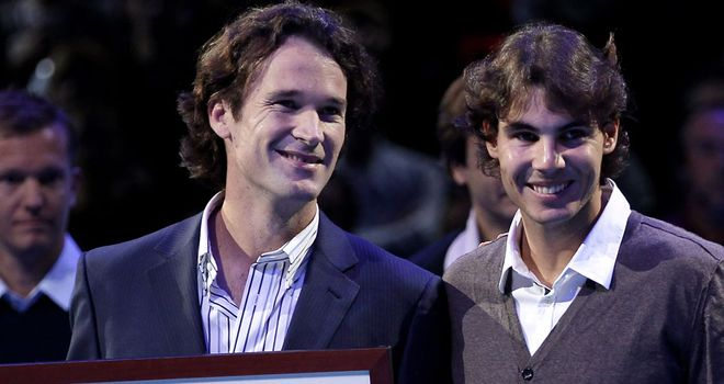 Spain's new Davis Cup skipper Carlos Moya (l) is keen to get close friend Rafael Nadal on board for the 2014 campaign which starts in January