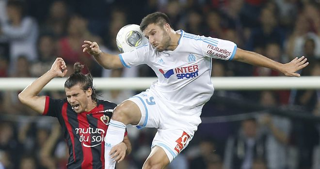 Andre-Pierre Gignac wins a header.