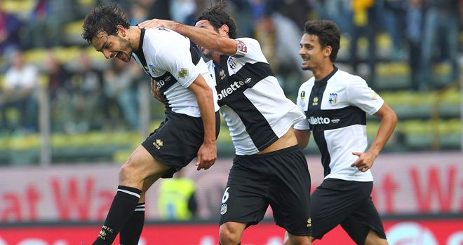 Marco Parolo and Parma celebrate.