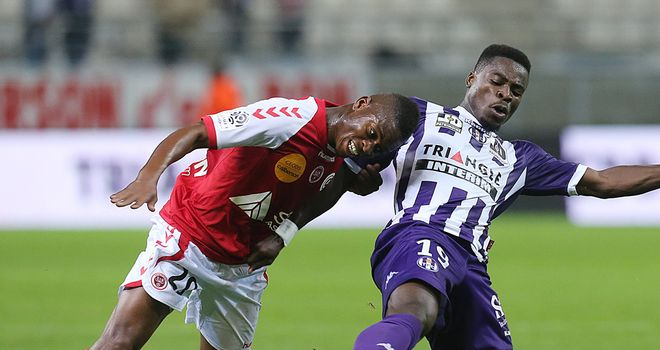 Floyd Ayite and Serge Aurier tangle.