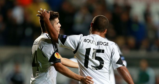 Wayne Routledge: Swansea winger celebrates after scoring the winner
