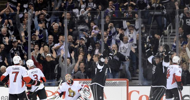 Jeff Carter celebrates his winning goal with Anze Kopitar