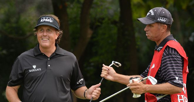 Phil Mickelson with caddie Jim 'Bones' Mackay during the pro-am for the WGC-HSBC Champions