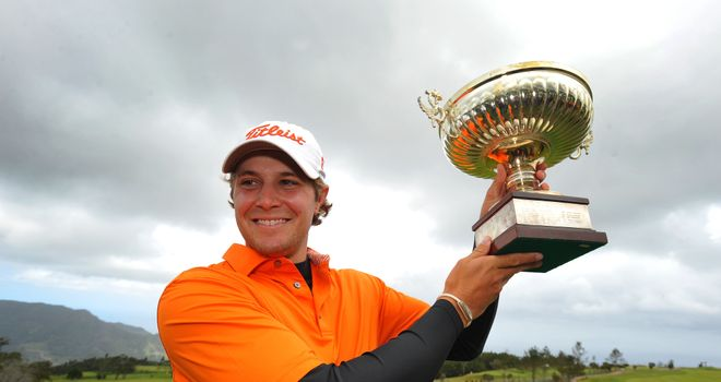 Peter Uihlein poses with the trophy after winning the Madeira Islands Open