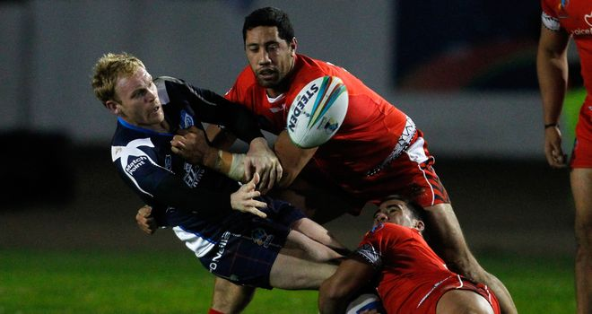 Peter Wallace: Offloads the ball during Scotland's win over Tonga in Workington