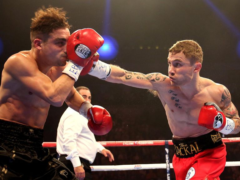 Carl Frampton (r) on the attack against Jeremy Parodi