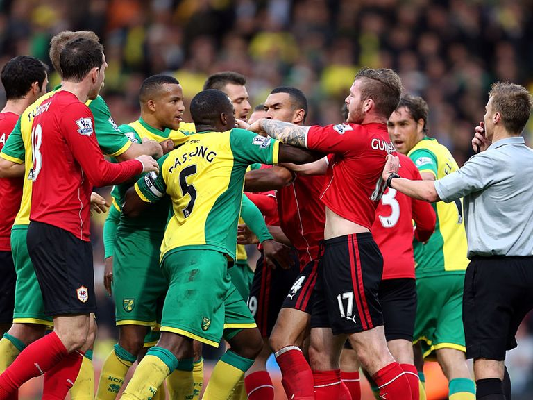 Norwich and Cardiff players clash at Carrow Road