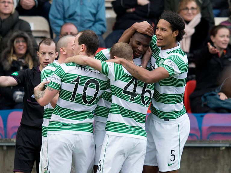 Celtic celebrate Amido Balde's winner at Partick.