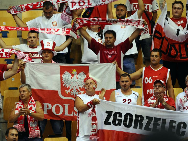 Poland fans standing for the national anthem