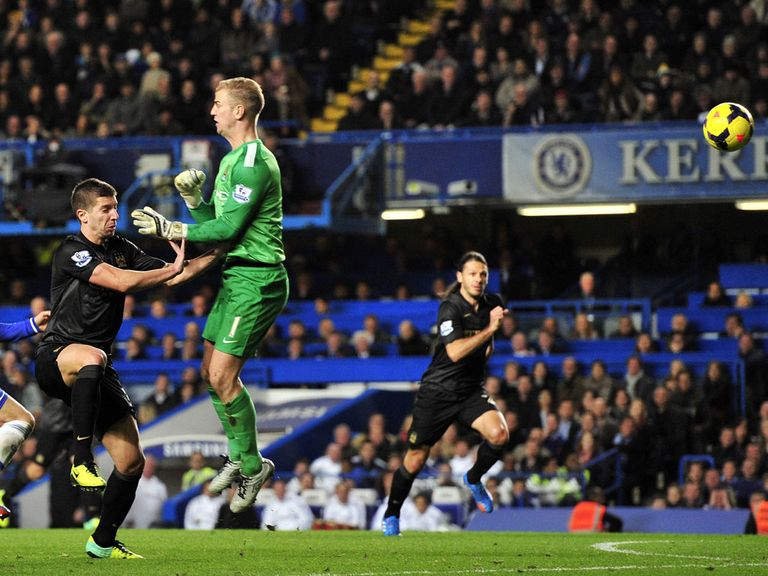 Joe Hart: Back in the firing line after this mix-up in Man City's defeat at Chelsea