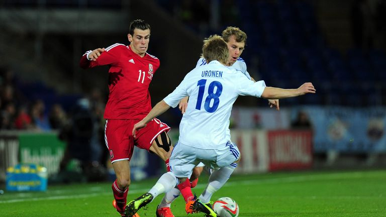 Bale is shackled by two Finnish players at the Millennium Stadium