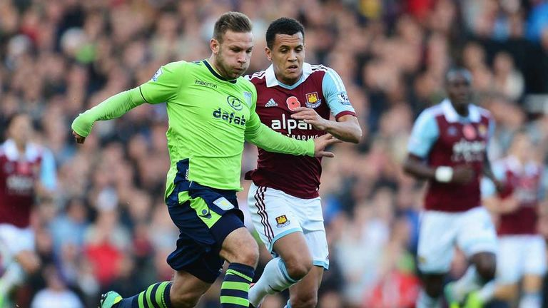 Andreas Weimann holds off Ravel Morrison before limping off with a hamstring injury