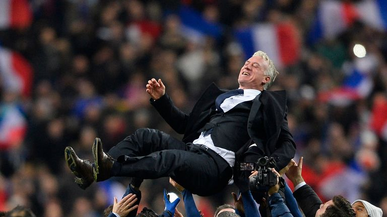 Didier Deschamps: Lifted by his players after the win over Ukraine