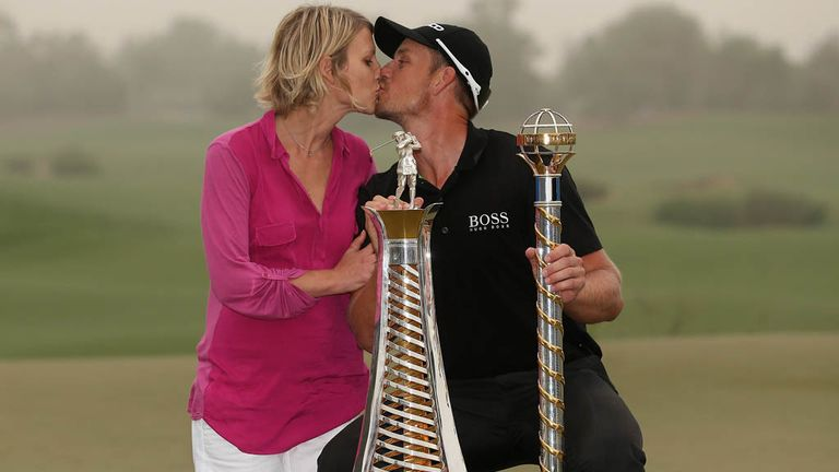 Henrik Stenson and his wife Emma celebrate Race to Dubai victory