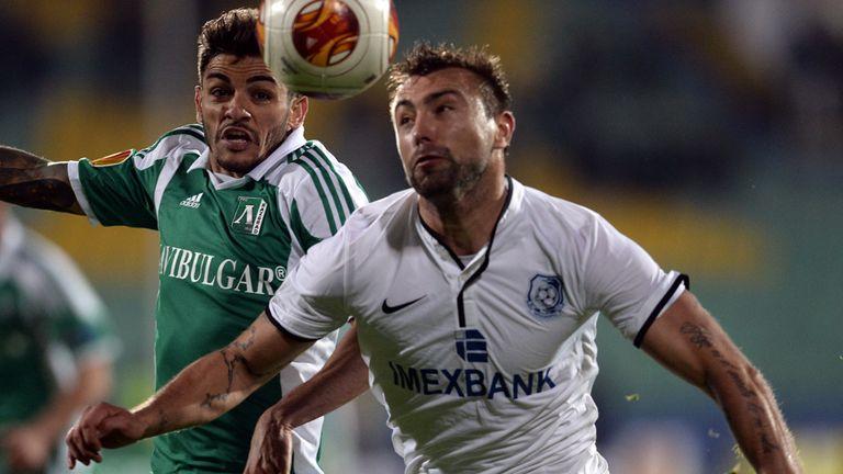 Junior Caicara and Olexiy Antonov battle for the ball