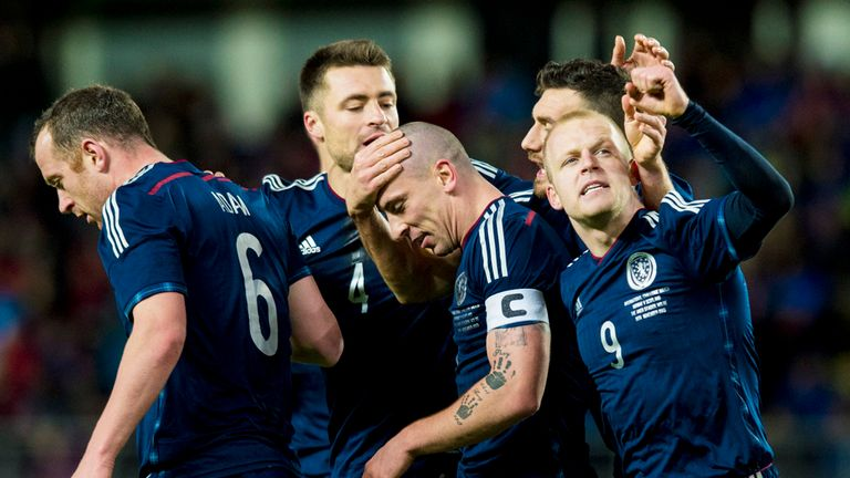 Scott Brown: Celebrates his winner with Scotland team-mates