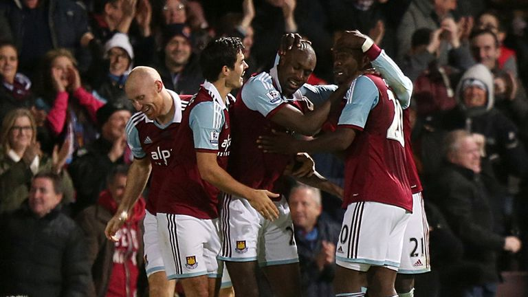 Carlton Cole: Mobbed by his team-mates after netting against Fulham