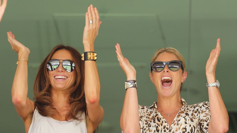 Ashes joy: Candice Falzon (R), partner of David Warner, celebrates with Kyly Clarke (L), wife of Michael Clarke, as Warner reaches his century on day three