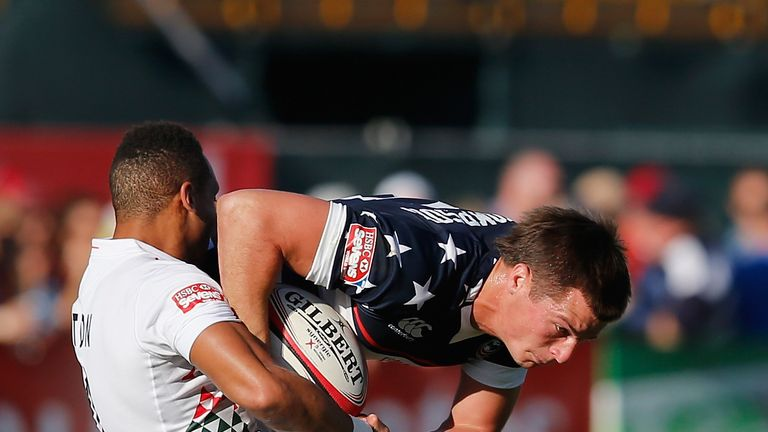Brett Thompson of the United States is tackled by Dan Norton of England