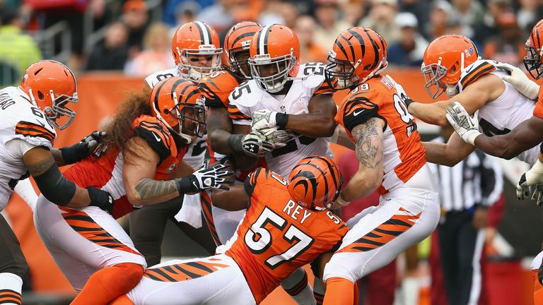 Chris Ogbonnaya of the Cleveland Browns is mauled by the Cincinnati Bengals