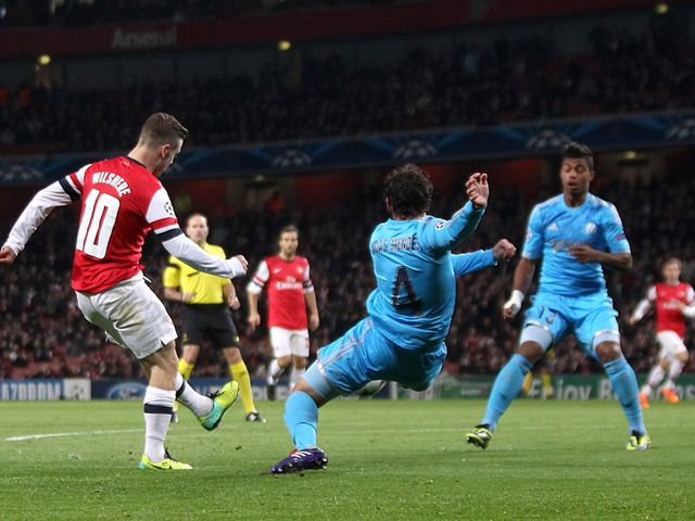 Jack Wilshere scores his first of two goals against Marseille
