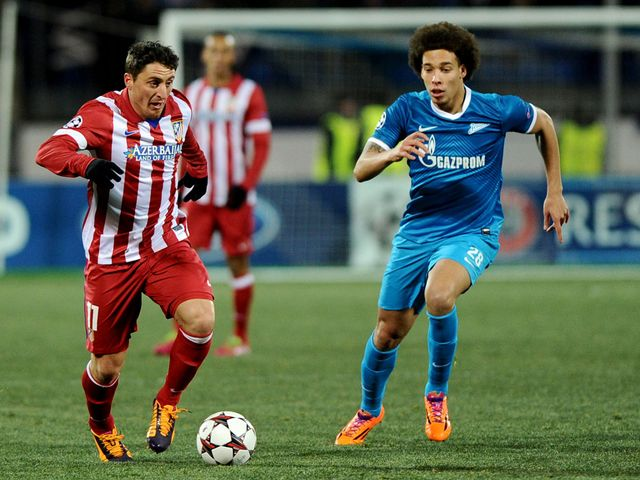 Cristian Rodriguez and Axel Witsel battle for the ball